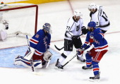 Henrik Lundqvist of the New York Rangers is scored on by Jake Muzzin of the Los Angeles Kings with Jeff Carter and Marian Gaborik of the Los Angeles...