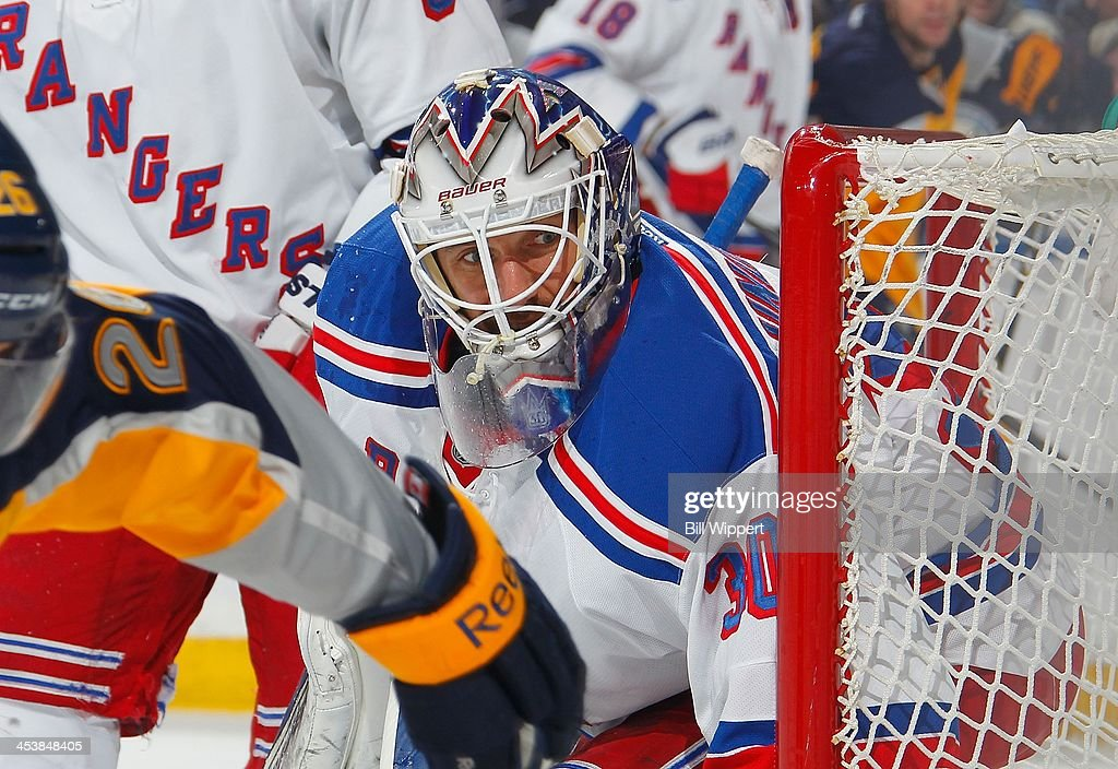 <a gi-track='captionPersonalityLinkClicked' href=/galleries/search?phrase=Henrik+Lundqvist&family=editorial&specificpeople=217958 ng-click='$event.stopPropagation()'>Henrik Lundqvist</a> #30 of the New York Rangers keeps an eye on the puck in the game against the Buffalo Sabres on December 5, 2013 at the First Niagara Center in Buffalo, New York.