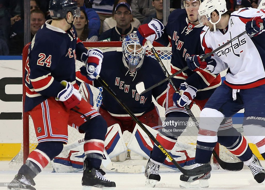 <a gi-track='captionPersonalityLinkClicked' href=/galleries/search?phrase=Henrik+Lundqvist&family=editorial&specificpeople=217958 ng-click='$event.stopPropagation()'>Henrik Lundqvist</a> #30 of the New York Rangers keeps his eye on the puck in the game against the Washington Capitals at Madison Square Garden on February 17, 2013 in New York City. The Rangers defeated the Capitals 2-1.
