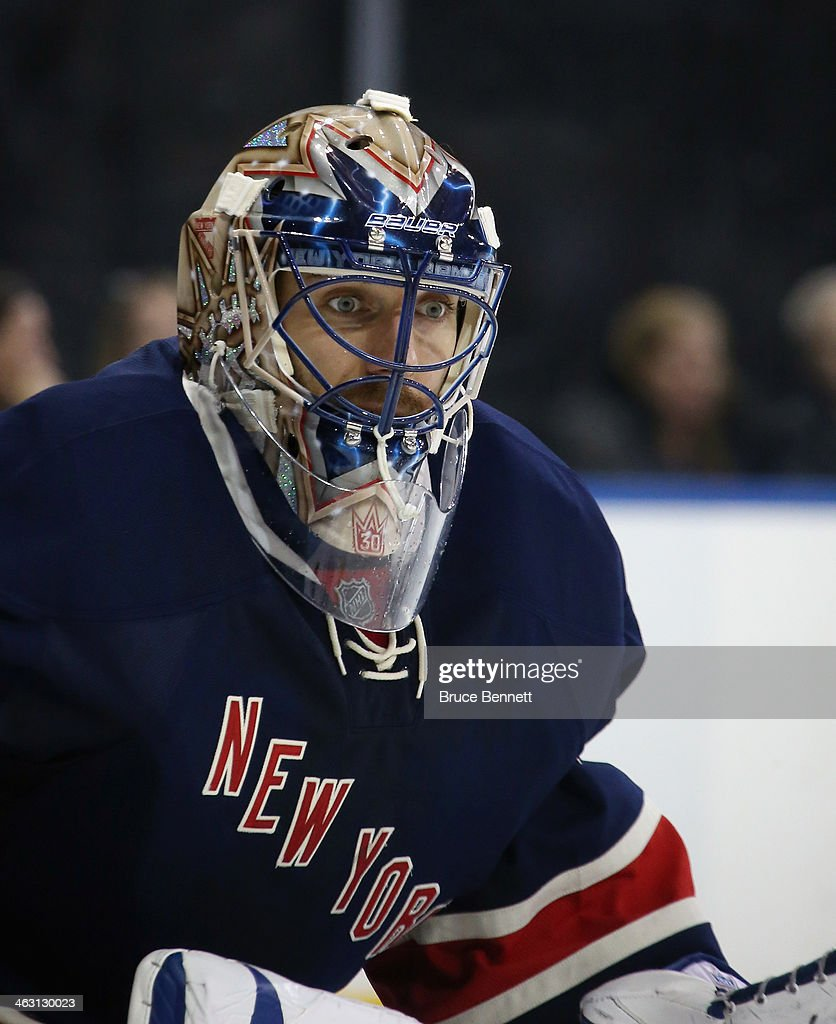<a gi-track='captionPersonalityLinkClicked' href=/galleries/search?phrase=Henrik+Lundqvist&family=editorial&specificpeople=217958 ng-click='$event.stopPropagation()'>Henrik Lundqvist</a> #30 of the New York Rangers keeps his eyes on the puck while wearing a new mask during the game against the Detroit Red Wings at Madison Square Garden on January 16, 2014 in New York City. The Rangers shutout the Red Wings 1-0.