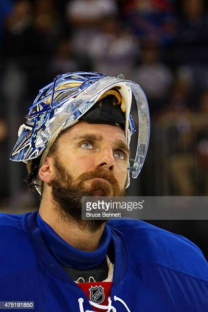 Henrik Lundqvist of the New York Rangers looks on after losing against the Tampa Bay Lightning by a score of 20 in Game Seven of the Eastern...