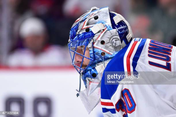 Henrik Lundqvist of the New York Rangers looks on against the Montreal Canadiens in Game Five of the Eastern Conference First Round during the 2017...