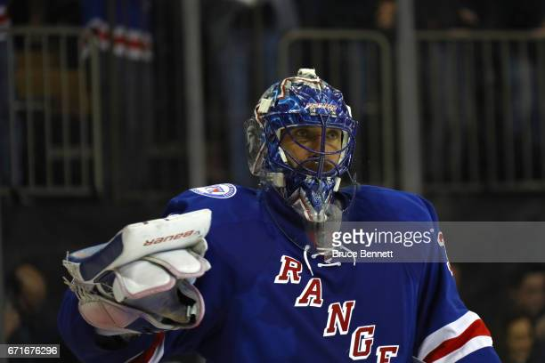 Henrik Lundqvist of the New York Rangers looks on against the Montreal Canadiens in Game Six of the Eastern Conference First Round during the 2017...