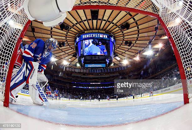 Henrik Lundqvist of the New York Rangers looks on before the second period of Game Seven of the Eastern Conference Finals during the 2015 NHL Stanley...