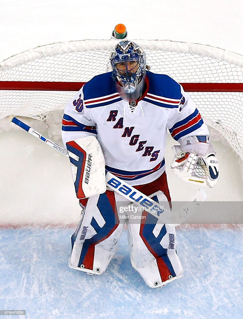 Henrik Lundqvist of the New York Rangers looks on during a break in play against the Tampa Bay Lightning in Game Four of the Eastern Conference...
