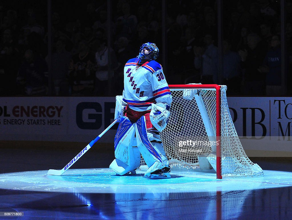 Henrik Lundqvist of the New York Rangers looks on during the National Anthem during a game against the Pittsburgh Penguins at Consol Energy Center on...