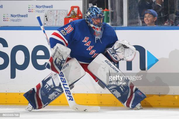 Henrik Lundqvist of the New York Rangers looks on during warmups before the game against the New York Islanders at Madison Square Garden on October...