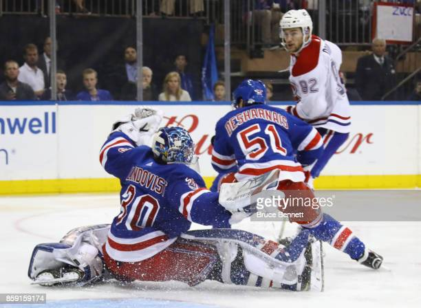 Henrik Lundqvist of the New York Rangers loses his stick making a save during the third period against Jonathan Drouin of the Montreal Canadiens at...