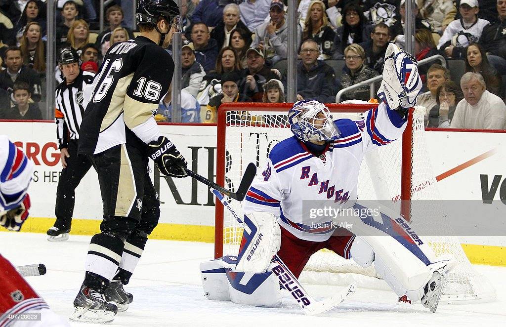 Henrik Lundqvist #30 of the New York Rangers makes a glove save against the Pittsburgh Penguins during the game at Consol Energy Center on February 7, 2014 in Pittsburgh, Pennsylvania.