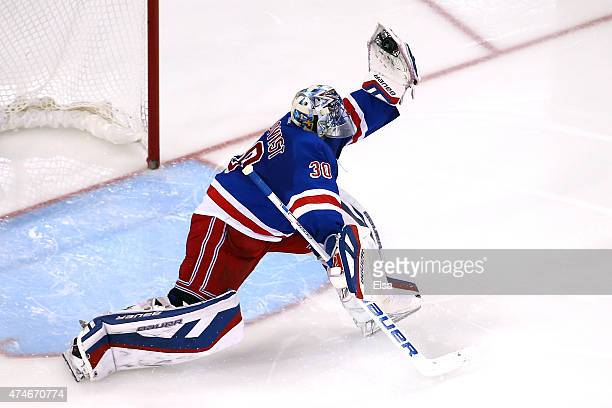 Henrik Lundqvist of the New York Rangers makes a glove save against the Tampa Bay Lightning during the second period in Game Five of the Eastern...