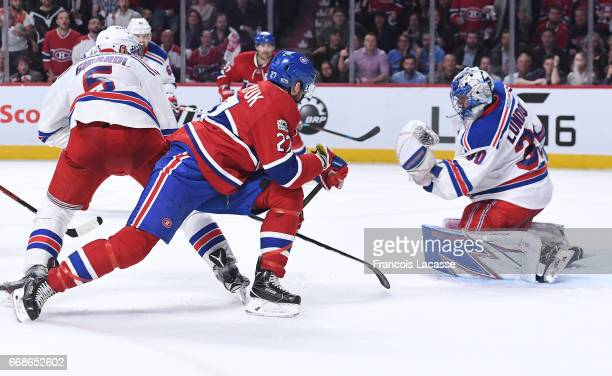 Henrik Lundqvist of the New York Rangers makes a glove save against Alex Galchenyuk of the Montreal Canadiens in Game Two of the Eastern Conference...