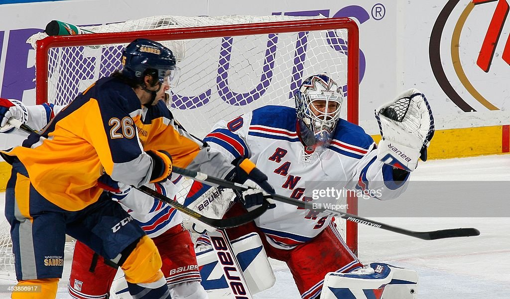 <a gi-track='captionPersonalityLinkClicked' href=/galleries/search?phrase=Henrik+Lundqvist&family=editorial&specificpeople=217958 ng-click='$event.stopPropagation()'>Henrik Lundqvist</a> #30 of the New York Rangers makes a glove save as <a gi-track='captionPersonalityLinkClicked' href=/galleries/search?phrase=Matt+Moulson&family=editorial&specificpeople=3365493 ng-click='$event.stopPropagation()'>Matt Moulson</a> #26 of the Buffalo Sabres looks for a deflection on December 5, 2013 at the First Niagara Center in Buffalo, New York. New York won, 3-1.