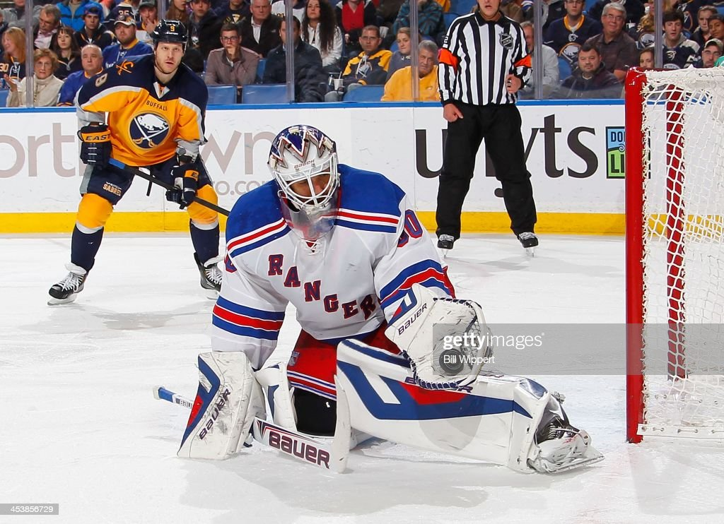 <a gi-track='captionPersonalityLinkClicked' href=/galleries/search?phrase=Henrik+Lundqvist&family=editorial&specificpeople=217958 ng-click='$event.stopPropagation()'>Henrik Lundqvist</a> #30 of the New York Rangers makes a glove save as <a gi-track='captionPersonalityLinkClicked' href=/galleries/search?phrase=Steve+Ott&family=editorial&specificpeople=210616 ng-click='$event.stopPropagation()'>Steve Ott</a> #9 of the Buffalo Sabres looks for a rebound on December 5, 2013 at the First Niagara Center in Buffalo, New York. New York won, 3-1.