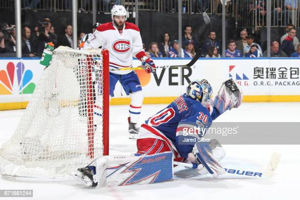 Henrik Lundqvist of the New York Rangers makes a glove save late in the second period against the Montreal Canadiens in Game Six of the Eastern...