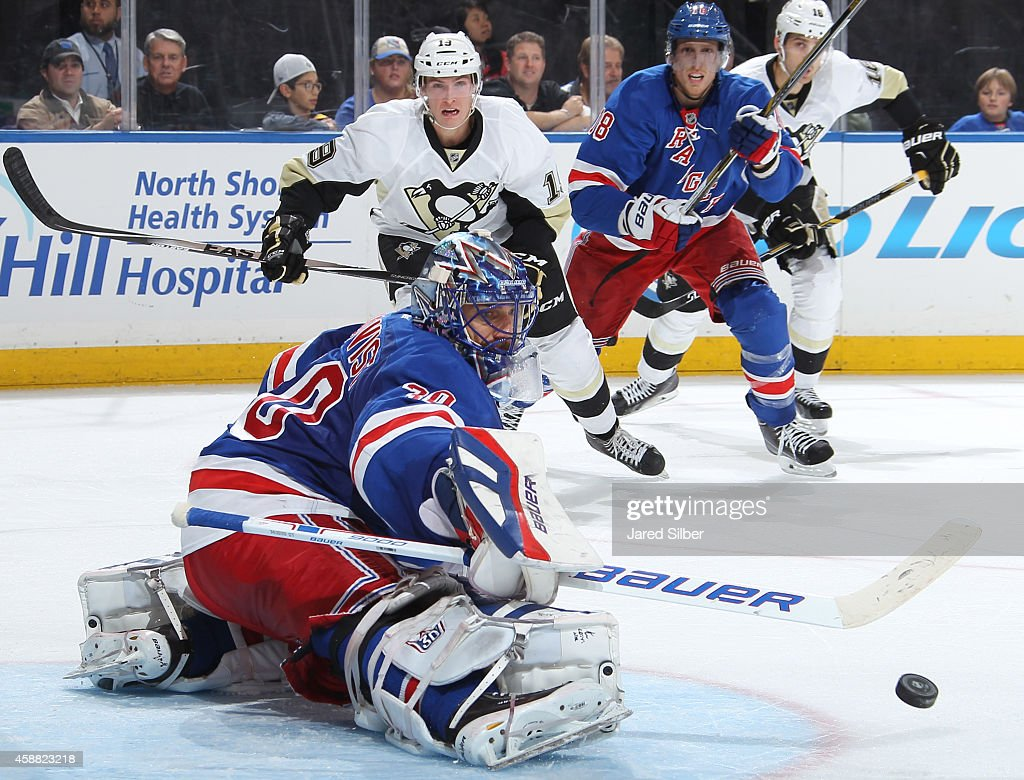 Henrik Lundqvist of the New York Rangers makes a kick save against the Pittsburgh Penguins at Madison Square Garden on November 11 2014 in New York...