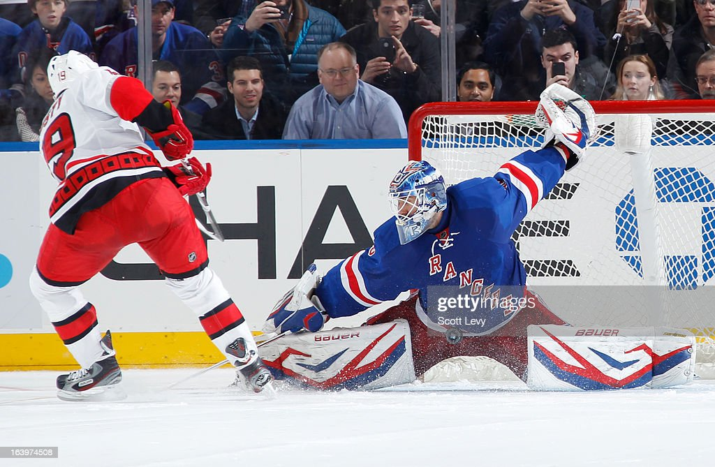 Henrik Lundqvist #30 of the New York Rangers makes a pad save against Jiri Tlusty #19 of the Carolina Hurricanes during a shootout at Madison Square Garden on March 18, 2013 in New York City.