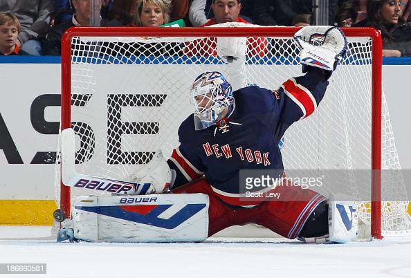 Henrik Lundqvist of the New York Rangers makes a pad save against the Carolina Hurricanes at Madison Square Garden on November 2 2013 in New York City