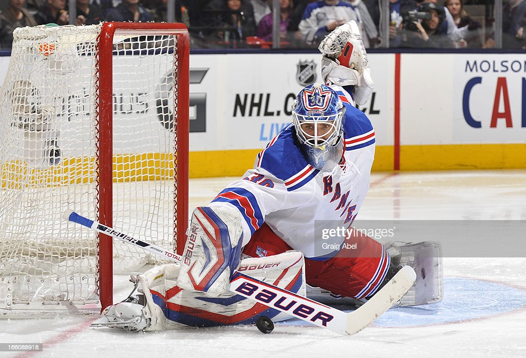 <a gi-track='captionPersonalityLinkClicked' href=/galleries/search?phrase=Henrik+Lundqvist&family=editorial&specificpeople=217958 ng-click='$event.stopPropagation()'>Henrik Lundqvist</a> #30 of the New York Rangers makes a pad save during NHL game action against the Toronto Maple Leafs April 8, 2013 at the Air Canada Centre in Toronto, Ontario, Canada.