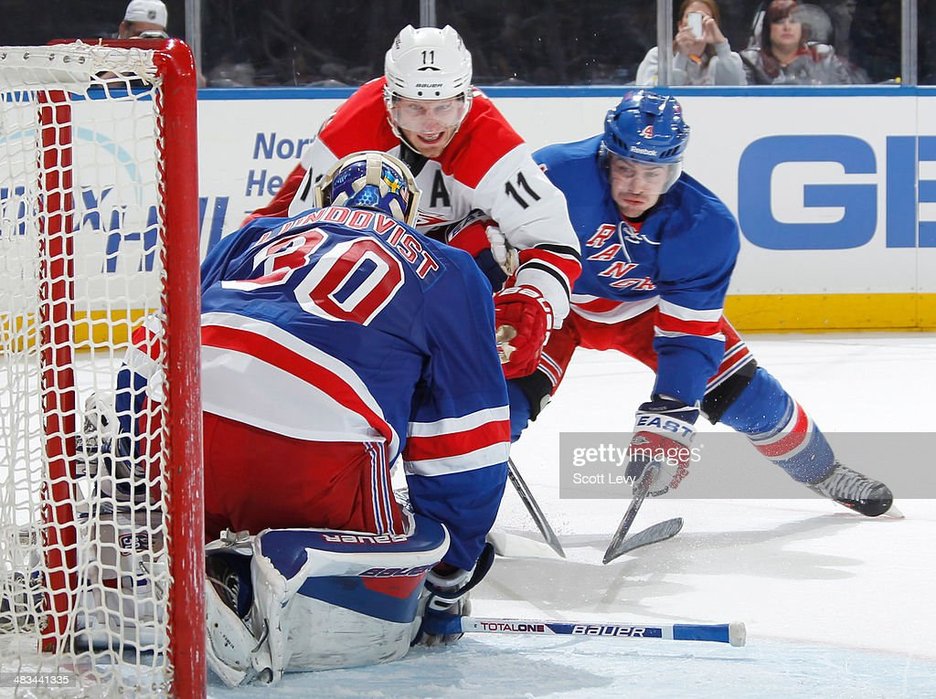 <a gi-track='captionPersonalityLinkClicked' href=/galleries/search?phrase=Henrik+Lundqvist&family=editorial&specificpeople=217958 ng-click='$event.stopPropagation()'>Henrik Lundqvist</a> #30 of the New York Rangers makes a save against <a gi-track='captionPersonalityLinkClicked' href=/galleries/search?phrase=Jordan+Staal&family=editorial&specificpeople=533044 ng-click='$event.stopPropagation()'>Jordan Staal</a> #11 of the Carolina Hurricanes at Madison Square Garden on April 08, 2014 in New York City.