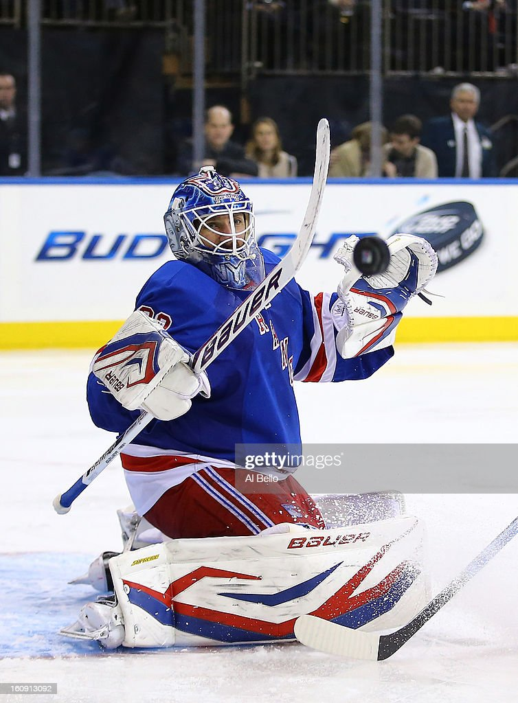 <a gi-track='captionPersonalityLinkClicked' href=/galleries/search?phrase=Henrik+Lundqvist&family=editorial&specificpeople=217958 ng-click='$event.stopPropagation()'>Henrik Lundqvist</a> #30 of the New York Rangers makes a save against the New York Islanders during their game at Madison Square Garden on February 7, 2013 in New York City.