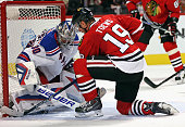 Henrik Lundqvist of the New York Rangers makes a save against Jonathan Toews of the Chicago Blackhawks at the United Center on October 7 2015 in...