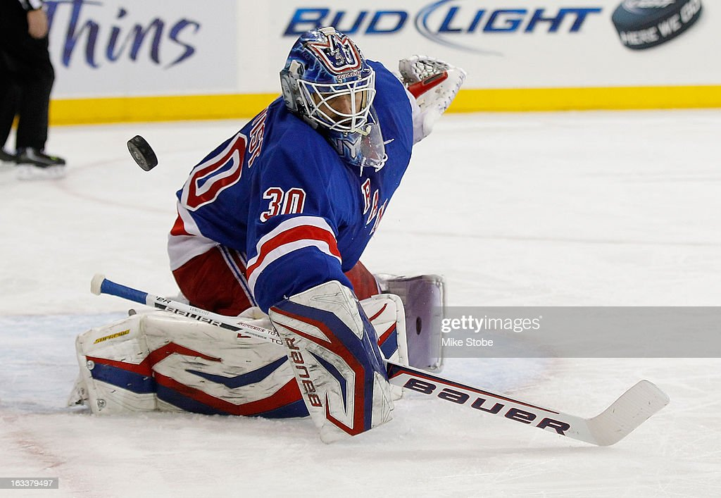 <a gi-track='captionPersonalityLinkClicked' href=/galleries/search?phrase=Henrik+Lundqvist&family=editorial&specificpeople=217958 ng-click='$event.stopPropagation()'>Henrik Lundqvist</a> #30 of the New York Rangers makes a save aganinst the Ottawa Senators at Madison Square Garden on March 8, 2013 in New York City. Senators defeated the Rangers 3-2.