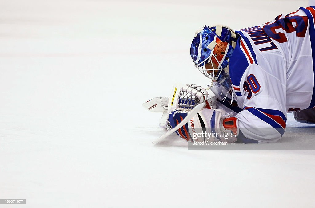 Henrik Lundqvist #30 of the New York Rangers makes a save and covers up the puck in the third period against the Boston Bruins in Game Two of the Eastern Conference Semifinals during the 2013 NHL Stanley Cup Playoffs on May 19, 2013 at TD Garden in Boston, Massachusetts.
