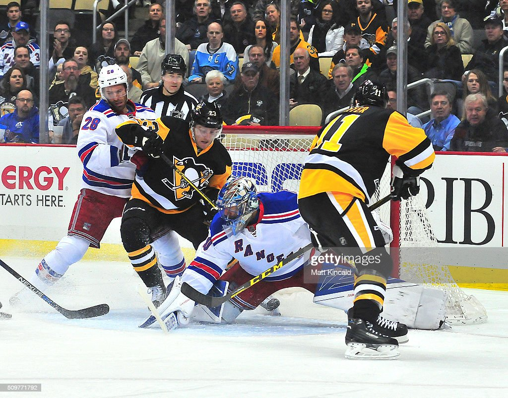 Henrik Lundqvist of the New York Rangers makes a save during a game against the Pittsburgh Penguins at Consol Energy Center on February 10 2016 in...
