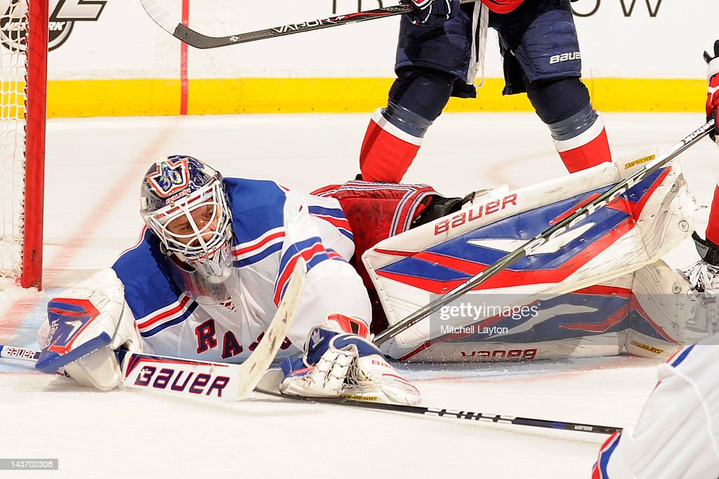 <a gi-track='captionPersonalityLinkClicked' href=/galleries/search?phrase=Henrik+Lundqvist&family=editorial&specificpeople=217958 ng-click='$event.stopPropagation()'>Henrik Lundqvist</a> #30 of the New York Rangers makes a save during Game Three of the Eastern Conference Semifinals of the 2012 NHL Stanley Cup Playoffs against the Washington Capitals on May 2, 2012 at the Verizon Center in Washington, DC.