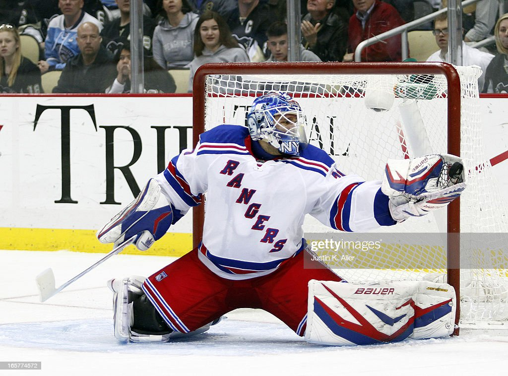 <a gi-track='captionPersonalityLinkClicked' href=/galleries/search?phrase=Henrik+Lundqvist&family=editorial&specificpeople=217958 ng-click='$event.stopPropagation()'>Henrik Lundqvist</a> #30 of the New York Rangers makes a save during his 500th career NHL game against the Pittsburgh Penguins during the game at Consol Energy Center on April 5, 2013 in Pittsburgh, Pennsylvania. The Penguins defeated the Rangers 2-1 in a shootout.
