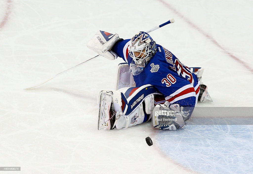 Henrik Lundqvist #30 of the New York Rangers makes a save during the second period of Game Four of the 2014 NHL Stanley Cup Final at Madison Square Garden on June 11, 2014 in New York, New York.