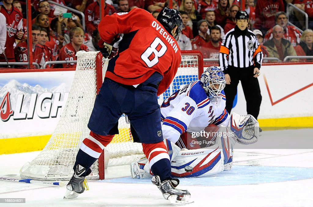 <a gi-track='captionPersonalityLinkClicked' href=/galleries/search?phrase=Henrik+Lundqvist&family=editorial&specificpeople=217958 ng-click='$event.stopPropagation()'>Henrik Lundqvist</a> #30 of the New York Rangers makes a save in the second period against Alex Ovechkin #8 of the Washington Capitals in Game Five of the Eastern Conference Quarterfinals during the 2013 NHL Stanley Cup Playoffs at the Verizon Center on May 10, 2013 in Washington, DC.
