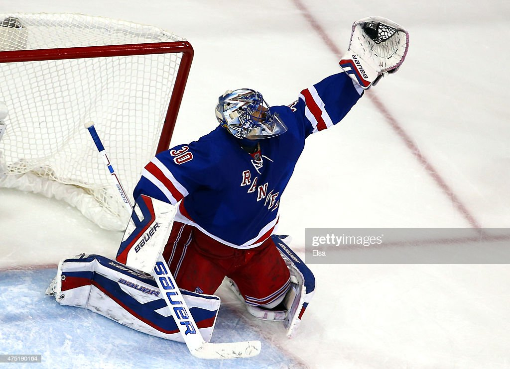 Henrik Lundqvist of the New York Rangers makes a save in the second period against the Tampa Bay Lightning in Game Seven of the Eastern Conference...