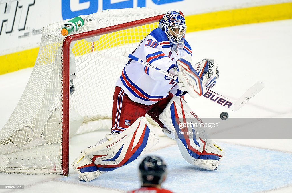 <a gi-track='captionPersonalityLinkClicked' href=/galleries/search?phrase=Henrik+Lundqvist&family=editorial&specificpeople=217958 ng-click='$event.stopPropagation()'>Henrik Lundqvist</a> #30 of the New York Rangers makes a save in the third period against the Washington Capitals in Game Seven of the Eastern Conference Quarterfinals during the 2013 NHL Stanley Cup Playoffs at the Verizon Center on May 13, 2013 in Washington, DC. New York won 5-0.