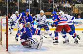 Henrik Lundqvist of the New York Rangers makes a save in the third period during a game against the Tampa Bay Lightning at Madison Square Garden on...