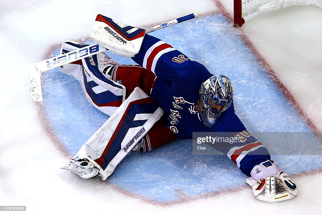 <a gi-track='captionPersonalityLinkClicked' href=/galleries/search?phrase=Henrik+Lundqvist&family=editorial&specificpeople=217958 ng-click='$event.stopPropagation()'>Henrik Lundqvist</a> #30 of the New York Rangers makes a save in the third period against the Tampa Bay Lightning in Game Seven of the Eastern Conference Finals during the 2015 NHL Stanley Cup Playoffs at Madison Square Garden on May 29, 2015 in New York City.