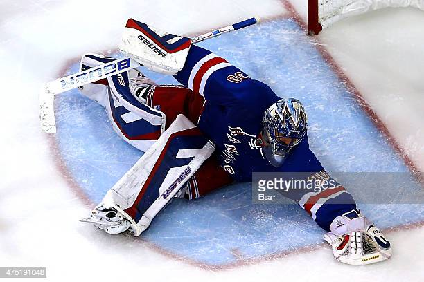 Henrik Lundqvist of the New York Rangers makes a save in the third period against the Tampa Bay Lightning in Game Seven of the Eastern Conference...