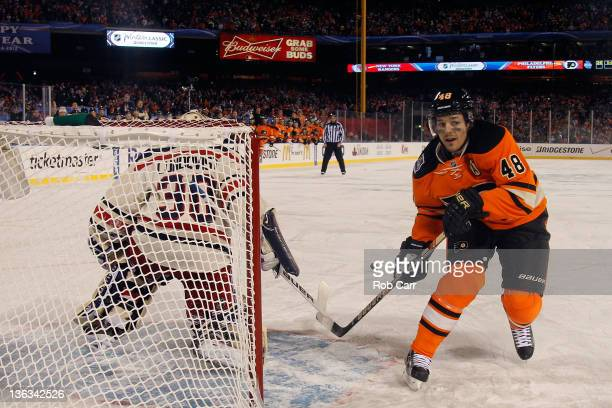 Henrik Lundqvist of the New York Rangers makes a save on a penalty shot by Danny Briere of the Philadelphia Flyers late in the third period during...