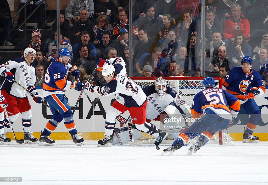 <a gi-track='captionPersonalityLinkClicked' href=/galleries/search?phrase=Henrik+Lundqvist&family=editorial&specificpeople=217958 ng-click='$event.stopPropagation()'>Henrik Lundqvist</a> #30 of the New York Rangers makes a save on a shot by <a gi-track='captionPersonalityLinkClicked' href=/galleries/search?phrase=Frans+Nielsen&family=editorial&specificpeople=634894 ng-click='$event.stopPropagation()'>Frans Nielsen</a> #51 of the New York Islanders at Madison Square Garden on January 31, 2014 in New York City.
