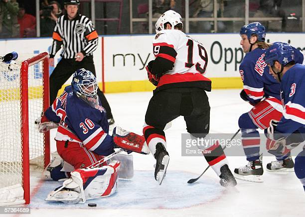 Henrik Lundqvist of the New York Rangers makes a save on a shot taken by Jason Spezza of the Ottawa Senators on April 18 2006 at Madison Square...