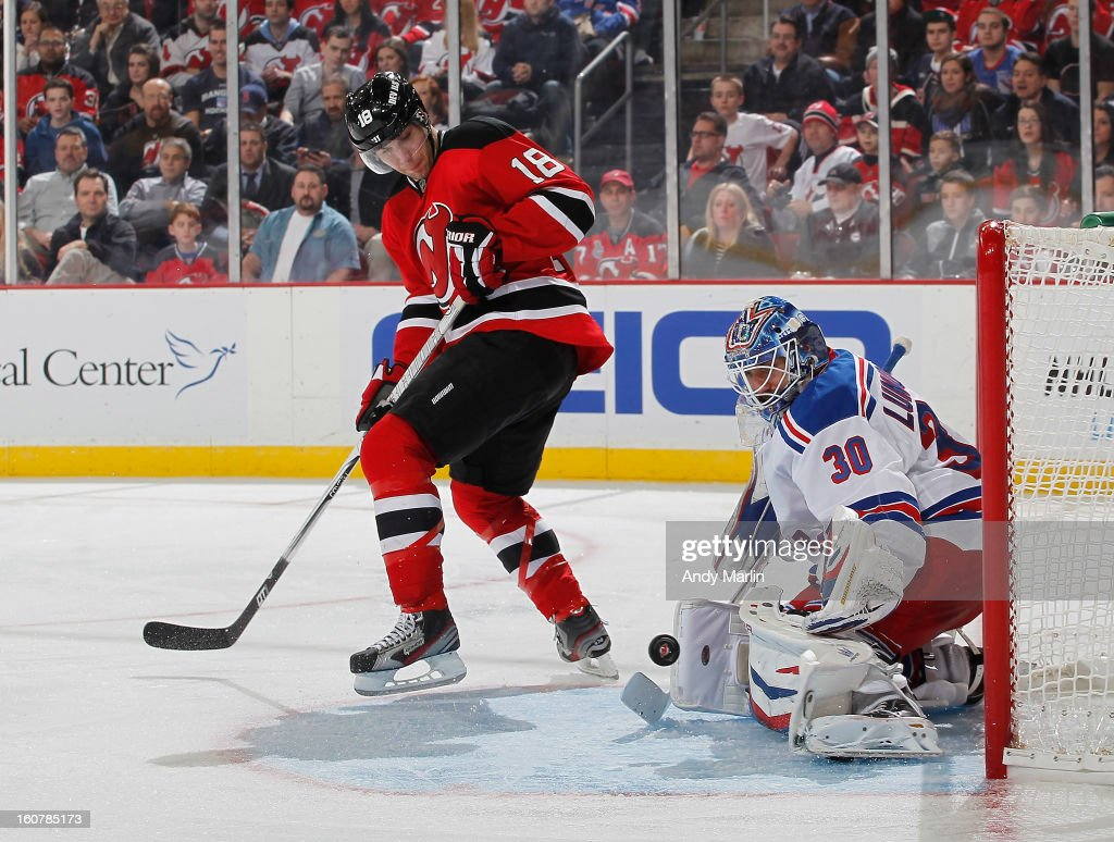 <a gi-track='captionPersonalityLinkClicked' href=/galleries/search?phrase=Henrik+Lundqvist&family=editorial&specificpeople=217958 ng-click='$event.stopPropagation()'>Henrik Lundqvist</a> #30 of the New York Rangers makes a save on a tip attempt by <a gi-track='captionPersonalityLinkClicked' href=/galleries/search?phrase=Steve+Bernier&family=editorial&specificpeople=557040 ng-click='$event.stopPropagation()'>Steve Bernier</a> #18 of the New Jersey Devils during the game at the Prudential Center on February 5, 2013 in Newark, New Jersey.