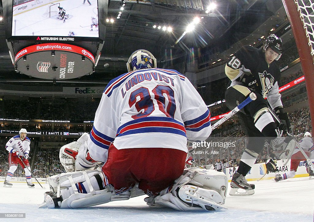 <a gi-track='captionPersonalityLinkClicked' href=/galleries/search?phrase=Henrik+Lundqvist&family=editorial&specificpeople=217958 ng-click='$event.stopPropagation()'>Henrik Lundqvist</a> #30 of the New York Rangers makes a save on <a gi-track='captionPersonalityLinkClicked' href=/galleries/search?phrase=James+Neal&family=editorial&specificpeople=1487991 ng-click='$event.stopPropagation()'>James Neal</a> #18 of the Pittsburgh Penguins during the game at Consol Energy Center on March 16, 2013 in Pittsburgh, Pennsylvania. The Penguins defeated the Rangers 3-0.