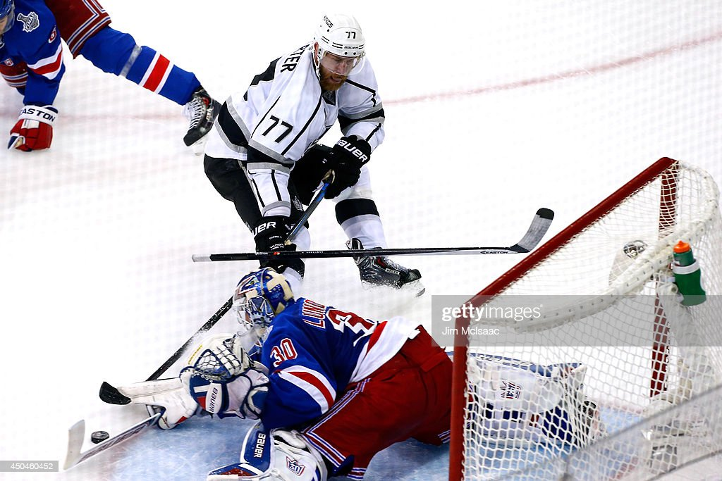 Henrik Lundqvist #30 of the New York Rangers makes a save on Jeff Carter #77 of the Los Angeles Kings during the second period of Game Four of the 2014 NHL Stanley Cup Final at Madison Square Garden on June 11, 2014 in New York, New York.