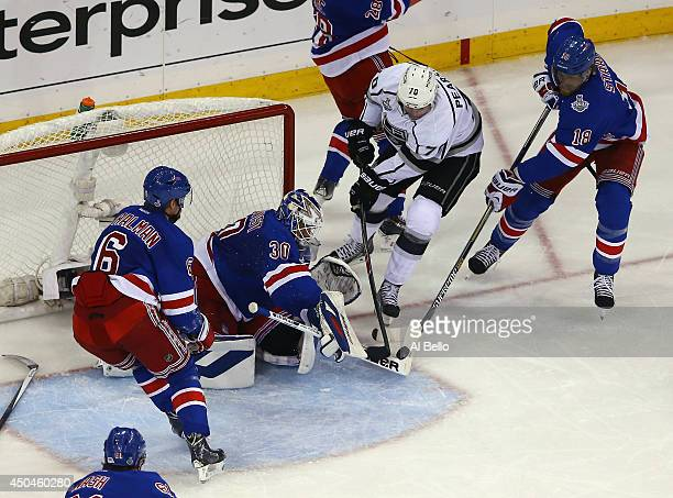 Henrik Lundqvist of the New York Rangers makes a save on Tanner Pearson of the Los Angeles Kings with Marc Staal of the New York Rangers defending...