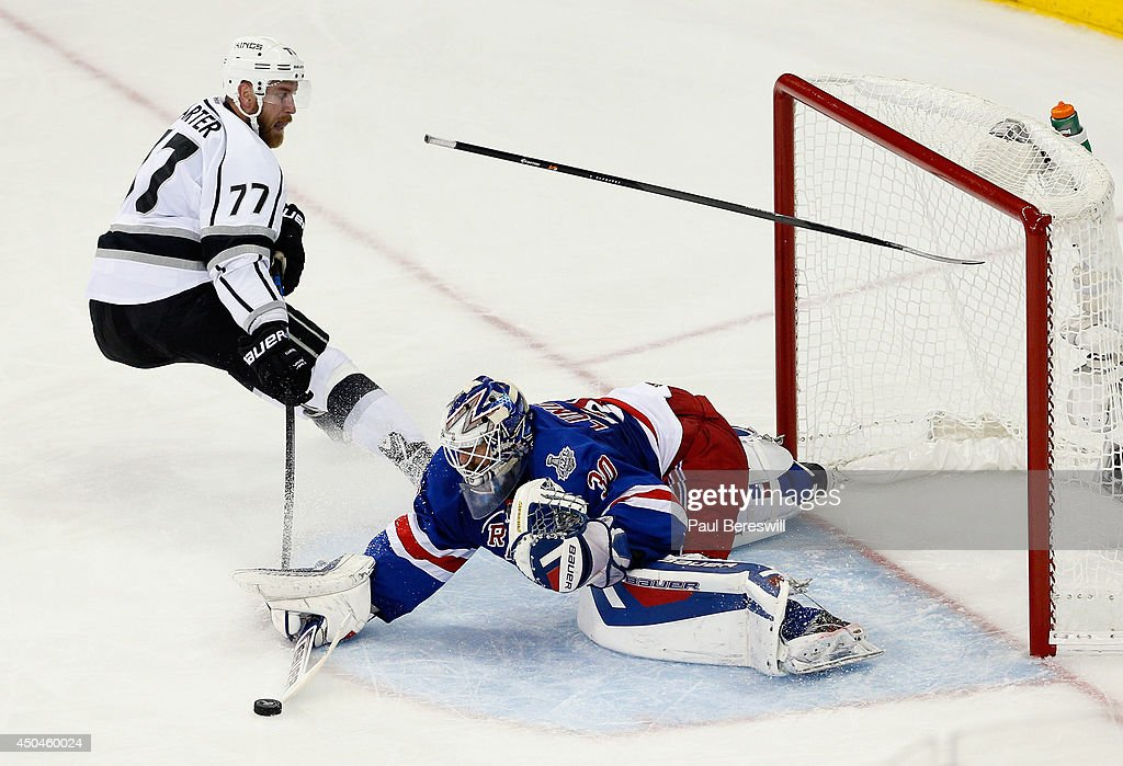 Henrik Lundqvist #30 of the New York Rangers makes a stick save on Jeff Carter #77 of the Los Angeles Kings during the second period of Game Four of the 2014 NHL Stanley Cup Final at Madison Square Garden on June 11, 2014 in New York, New York.