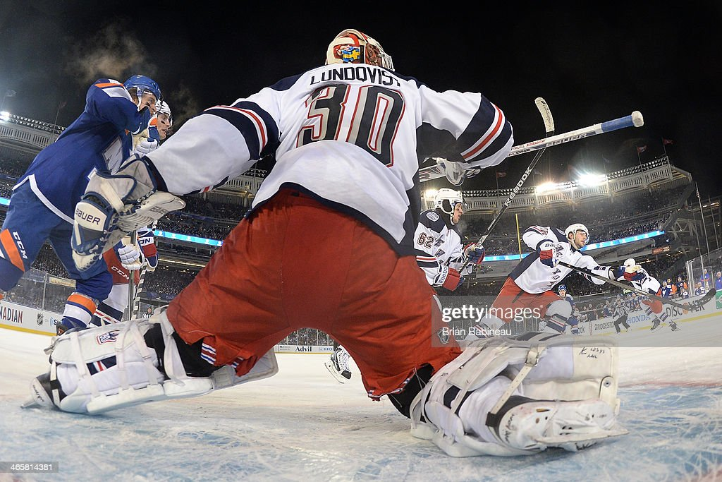 <a gi-track='captionPersonalityLinkClicked' href=/galleries/search?phrase=Henrik+Lundqvist&family=editorial&specificpeople=217958 ng-click='$event.stopPropagation()'>Henrik Lundqvist</a> #30 of the New York Rangers makes a stop during the 2014 Coors Light NHL Stadium Series against the New York Islanders at Yankee Stadium on January 29, 2014 in the Bronx borough of New York City.