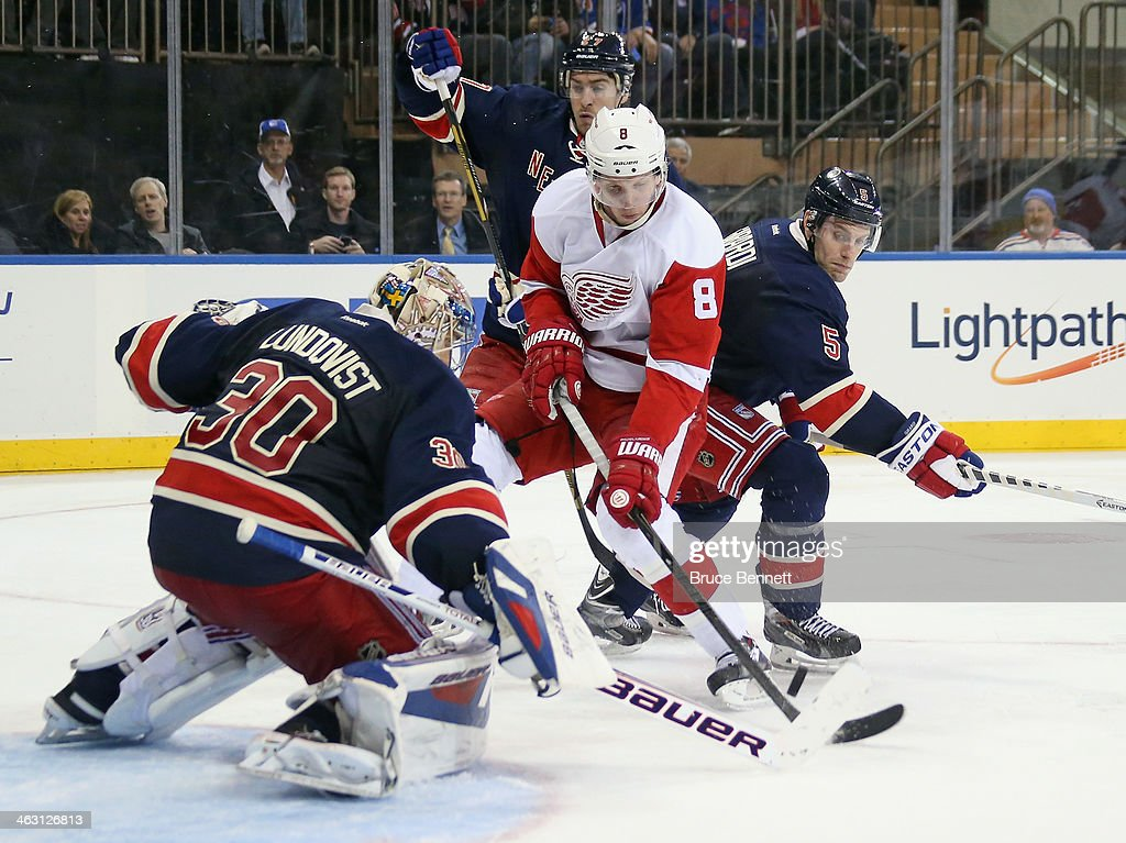 <a gi-track='captionPersonalityLinkClicked' href=/galleries/search?phrase=Henrik+Lundqvist&family=editorial&specificpeople=217958 ng-click='$event.stopPropagation()'>Henrik Lundqvist</a> #30 of the New York Rangers makes a third period save against <a gi-track='captionPersonalityLinkClicked' href=/galleries/search?phrase=Justin+Abdelkader&family=editorial&specificpeople=2271858 ng-click='$event.stopPropagation()'>Justin Abdelkader</a> #8 of the Detroit Red Wings at Madison Square Garden on January 16, 2014 in New York City. The Rangers shutout the Red Wings 1-0.