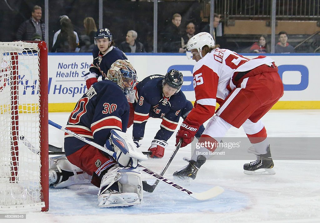Henrik Lundqvist #30 of the New York Rangers makes the first period save on Danny DeKeyser #65 of the Detroit Red Wings at Madison Square Garden on January 16, 2014 in New York City.
