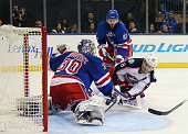 Henrik Lundqvist of the New York Rangers makes the first period save on Boone Jenner of the Columbus Blue Jackets at Madison Square Garden on October...