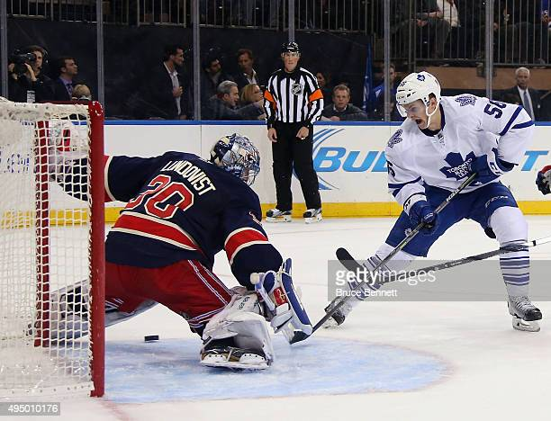 Henrik Lundqvist of the New York Rangers makes the first period save on Byron Froese of the Toronto Maple Leafs at Madison Square Garden on October...